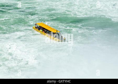 excursion boat, River Rhine Falls near Schaffhausen, Laufen-Uhwiesen, Switzerland - Stock Photo