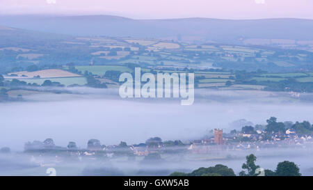 Moretonhampstead town and church at dawn on a misty morning, Dartmoor National Park, Devon, England. Summer (July) - Stock Photo