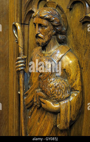 St Wilfrids Church Grappenhall- Pulpit wood carving of shepherd - Warrington - Stock Photo