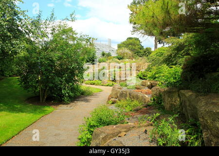 Path through rock garden plants, Kew Gardens, Royal Botanic Gardens, London, England, UK - Stock Photo