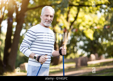 Handsome grey man jogging in the park - Stock Photo