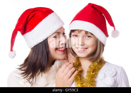 Mother and daughter sharing each other secrets on Christmas Eve - Stock Photo