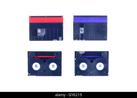 red and blue mini DV cassette on isolated background. - Stock Photo