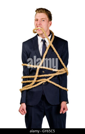 Young businessman in a suit tied up - Stock Photo