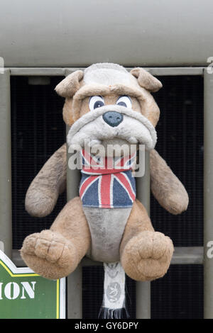 British Bulldog toy attached to grill on a British Army Jeep - Stock Photo