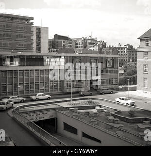 1960s, historical, new modern high rise office buildings in the city of London, with the Barbican Restaurant in - Stock Photo