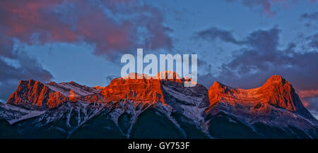 Sunset glow on the mountains in Canmore - Stock Photo