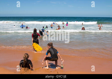Families and children enjoying the ocean at Bilgola Beach,Sydney during summer, Australia - Stock Photo