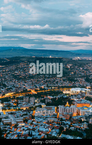 Tbilisi, Georgia. The Aerial Cityscape View Of Capital In Evening Illimination, The Modern City District Of High - Stock Photo