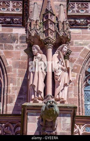 Ornate statues on the exterior of Freiburg Minster, Freiburg im Breisgau, Germany - Stock Photo