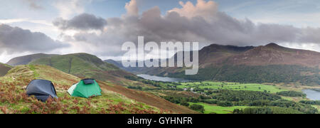 Two tents for a weekend of wild camping on Rannerdale Knotts overlooking Buttermere in the English Lake District - Stock Photo