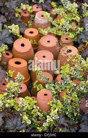 Upside down Terracotta Flower pots - Stock Photo