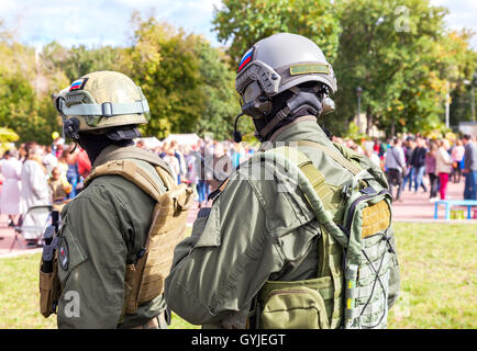 Unidentified members of military club in camouflage army uniform and helmet (full gear) - Stock Photo