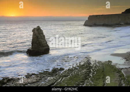 Pacific Ocean sunset from San Vicente Creek, Davenport, California, USA - Stock Photo