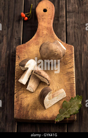 Sliced cep mushrooms on cutting board - Stock Photo