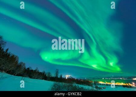 aurora eddy over island Kvaloya, Norway, Troms, Kvaloeya, Tromsoe - Stock Photo