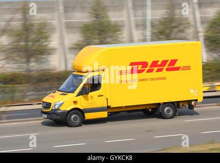 Yellow DHL van near London Heathrow Airport - Stock Photo