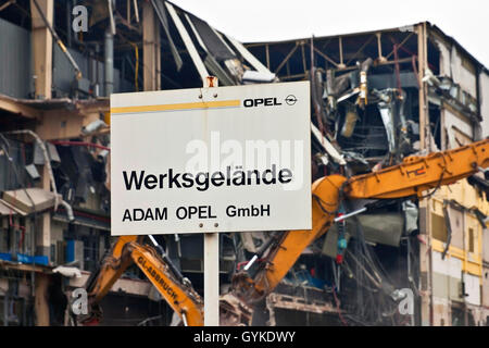 opel car company sign in front of demolition work, Germany, North Rhine-Westphalia, Ruhr Area, Bochum - Stock Photo