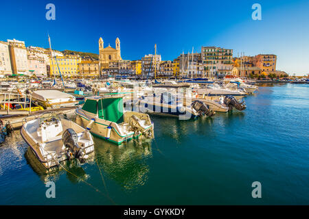 View to old city center of Bastia town with Joannis Babtistes Cathedral and boats in port, France, Europe. - Stock Photo