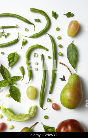 Green vegetables and fruits isolated on white. Ingredients for diet - Stock Photo