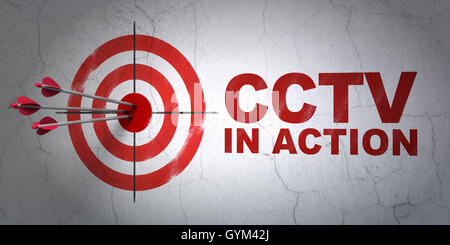 Safety concept: target and CCTV In action on wall background - Stock Photo
