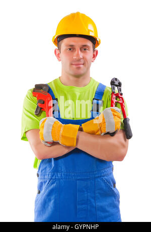 worker holding  pipe wrench and steel cutter - Stock Photo