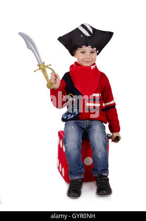 Small boy dressed like pirate holding toy sword - Stock Photo