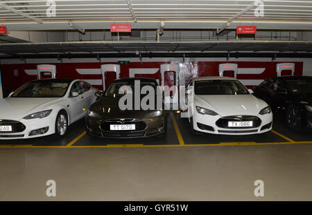 Tesla cars charging station in Cyberport, Hong Kong. - Stock Photo