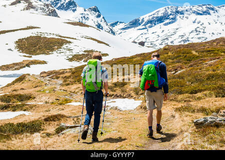 Two hikers on trail, snow melt, Rohrmoos-Untertal, Schladming Tauern, Schladming, Styria, Austria - Stock Photo