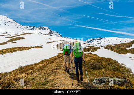 Two hikers hiking on trail, snow melt, Rohrmoos-Untertal, Schladming Tauern, Schladming, Styria, Austria - Stock Photo
