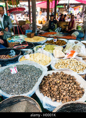 Market stall with dried fruits in Nampan, Inle Lake, Shan State, Myanmar - Stock Photo