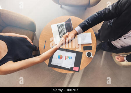 Business colleagues handshake. Businesspeople shaking hands after a successful meeting. - Stock Photo
