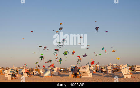 roofed wicker beach chairs and flying kites on sandy beach, Germany, Schleswig-Holstein, Northern Frisia, St. Peter - Stock Photo
