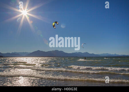 kite-surfer in front of Alp scenery in backlight, Germany, Bavaria, Lake Chiemsee - Stock Photo