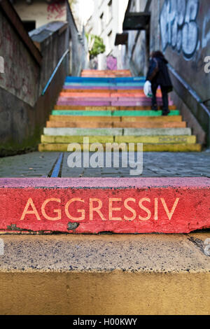 the word 'aggessive' on colourful perron, Scala, Holsteiner Treppe, Germany, North Rhine-Westphalia, Bergisches - Stock Photo