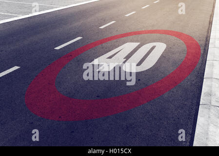40 kmph or mph driving speed limit sign on highway, road safety and preventing traffic accident concept. - Stock Photo