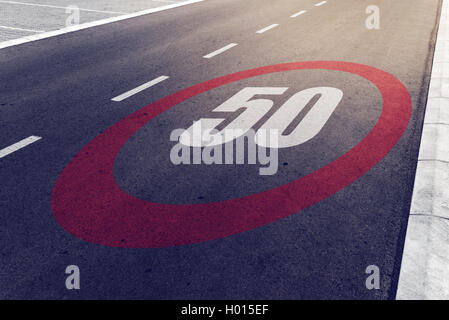 50 kmph or mph driving speed limit sign on highway, road safety and preventing traffic accident concept. - Stock Photo
