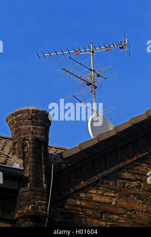 television antenna and satellite dish on a roof, Germany - Stock Photo