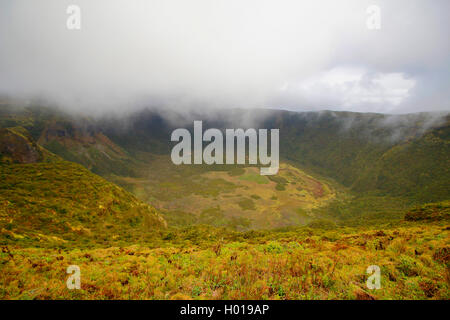 view into the mist covered crater, Portugal, Azores, Faial, Caldeira dos Capelinhos - Stock Photo