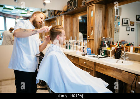 Hair beard and mustache treatment in barber shop - Stock Photo