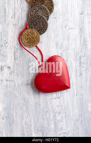 Vintage  heart decoration and old coins - Stock Photo