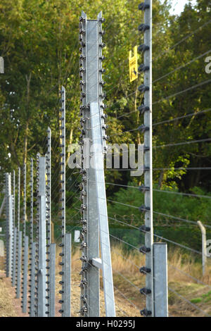 Electrified security fence Good depth selective focus image. - Stock Photo