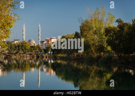 Image of mosque reflecting in the river. Manavgat, Turkey. - Stock Photo