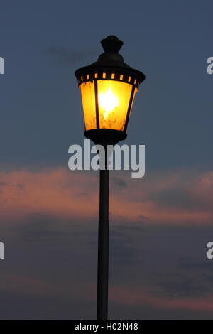 street lamp against a beautiful sky at dusk, Roma, Rome - Stock Photo