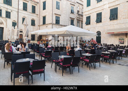 DUBROVNIK, CROATIA - MAY 28, 2014: Guests sitting at restaurant terrace. Dubrovnik has many restaurants which offer - Stock Photo