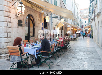 DUBROVNIK, CROATIA - MAY 28, 2014: Guests sitting at Proto restaurant terrace, one of Dubrovnik's best known places - Stock Photo