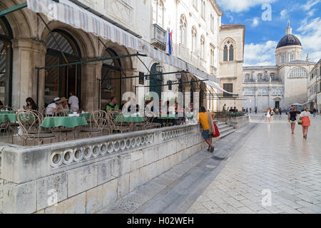 DUBROVNIK, CROATIA - MAY 28, 2014: Guests sitting at terrace of Gradska kavana, famous coffee place. - Stock Photo
