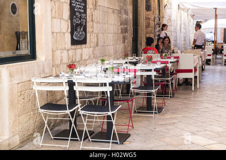 DUBROVNIK, CROATIA - MAY 28, 2014: Guests sitting at restaurant street terrace. - Stock Photo