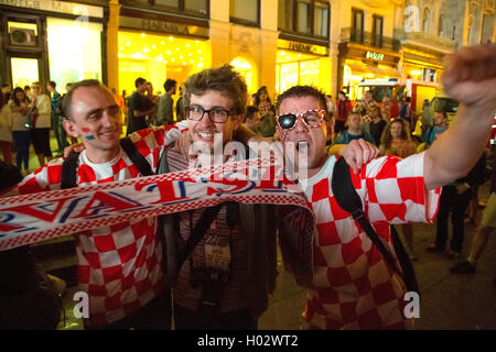 ZAGREB, CROATIA - JUNE 12, 2014: Croatian football fans at Ban Josip Jelacic square support their national team - Stock Photo