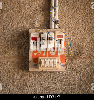 HAMPI, INDIA - 28 JANUARY 2015: Small safety fuse with switches on stone wall. - Stock Photo